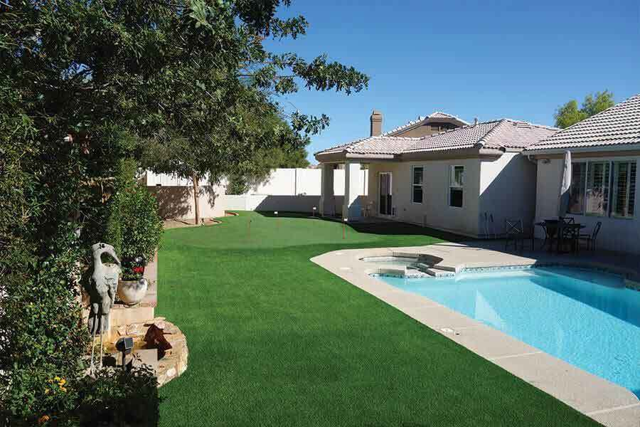 Synthetic grass surrounding pool pool