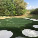 large, private golf green with multiple sand bunkers