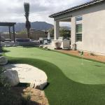 side yard of phoenix home with private putting green