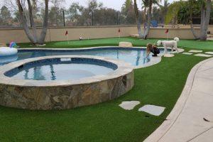 residential artificial grass around backyard pool