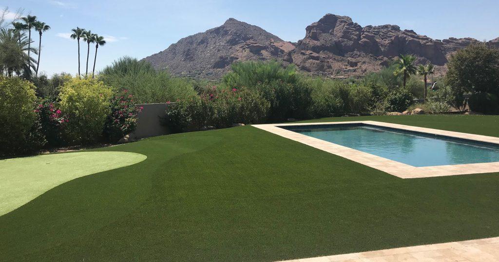 private backyard artificial grass pool surround